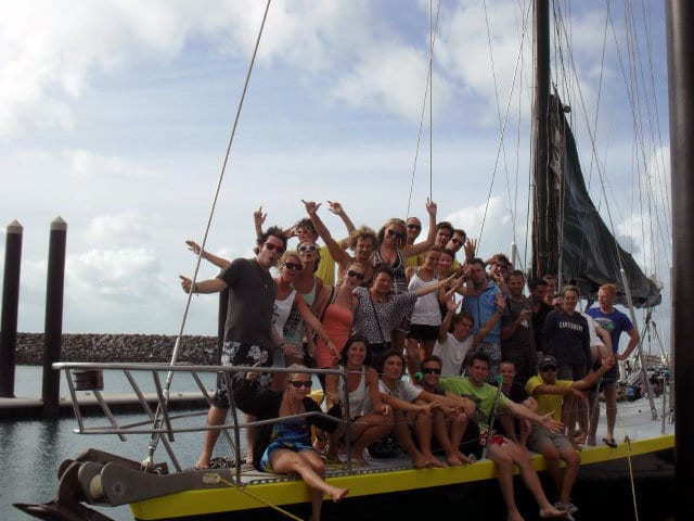Guest in a group photo on the bow of Apollo