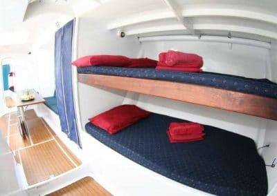 British Defender - Interior Midship Bunks and Table - Explore Whitsundays (Small)
