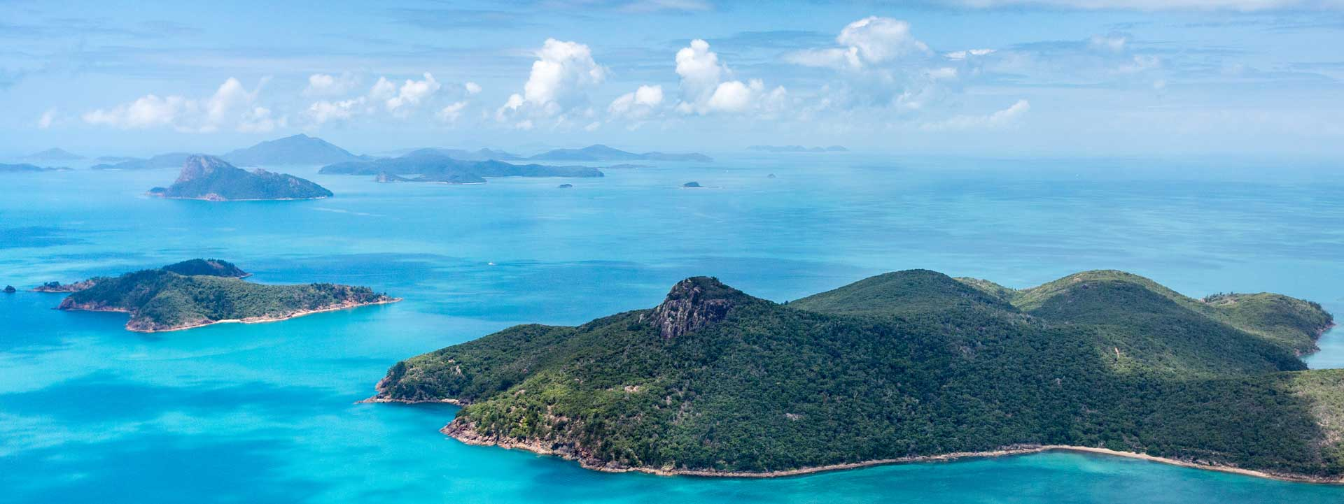 Aerial view of Airlie Beach Weather over the Whitsundays