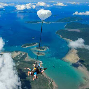 Tandam skydiving free falling over the islands in Queensland